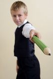Brave schoolboy with pencil. Brave schoolboy with big pencil Stock Photo