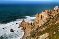 Brave sea and cliffs of the coast of Azenhas do Mar in Portugal. Beautiful brave sea and cliffs of the coast of Azenhas do Mar in Portugal in Spring nature royalty free stock image