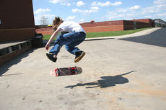 Brave Skateboarder Doing 360 Flip. Att inspector: Shirt was altered in Adobe Photoshop to hide logos. Skateboarder in action in air doing a 360 flip of his board Stock Photography