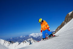 Brave small boy skiing alone on mountain slope Royalty Free Stock Photos