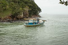 Small fish boat sets out to open sea Royalty Free Stock Photography