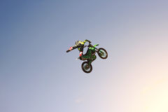 Brave stunt biker doing a difficult trick. Extreme sport Stock Photo