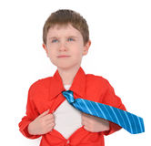 Brave Super Hero Boy Child with Open Shirt. A young boy is holding his shirt open with his tie flying for a super hero rescue concept. His shirt is red and the Stock Image