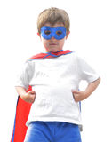 Brave Super Hero Boy on White. A young boy is wearing a superhero mask and cape and looks brave on a white background Stock Images