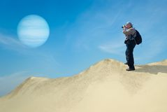 Brave tourist on a desolate planet Royalty Free Stock Images