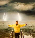 Brave woman. Greeting stormy ocean Royalty Free Stock Photos