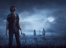 Brave woman with vest find the zombies. Brave women with vest find the zombies on the meadow at night royalty free stock images
