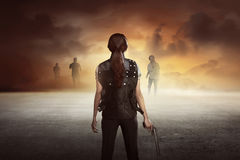 Brave woman with vest shoot the zombies. Brave women with shoot the zombies on the street Royalty Free Stock Photography