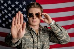Brave young officer is ready to protect country stock photography