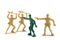 Bravery Concept - Plastic Soldiers. Isolated Plastic Toy Soldiers - Courage Concept by Prematurely Surrendering Soldiers Royalty Free Stock Photography