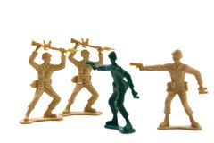 Bravery Concept - Plastic Soldiers. Isolated Plastic Toy Soldiers - Courage Concept by Prematurely Surrendering Soldiers Stock Image