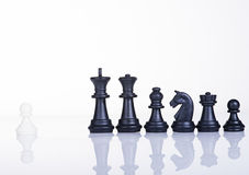 Bravery Leadership concept. A pawn want fight with black army chips: bravery concept Stock Image