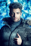 Bravery. Portrait of a handsome man dressed in winter clothes, covered with frost Royalty Free Stock Photography