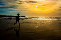 Bravery. He runs to the roaring ocean to explore, learn and appreciate the creation that excites him Stock Image