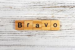 BRAVO word made with wooden blocks concept Stock Image