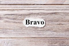 BRAVO of the word on paper. concept. Words of BRAVO on a wooden background Stock Image