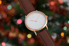 Brawn leather strap wrist watch in Christmas time Royalty Free Stock Photos