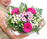 Brawny man s hand with a bouquet of flowers Royalty Free Stock Images