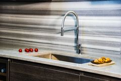 Brawon kitchen cabinets with white kitchen granite countertop. Counter concept. royalty free stock photos
