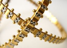 Brazalete V del oro Imágenes de archivo libres de regalías