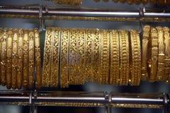 Brazaletes preciosos del oro Fotografía de archivo libre de regalías