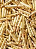 Brazen ammunition background. Pile of golden rifle cartridges Stock Image