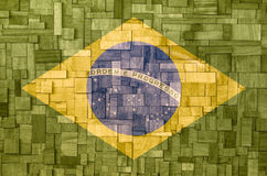 Brazilian flag on a wooden Texture. Brazian flag on a wooden textured panel perfect representing the connection between wood and brazilian amazon forest Royalty Free Stock Photos