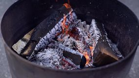 Brazier from barrel of firewood. Shot in slow motion. Close-up of bbq fireplace outdoors stock video