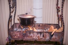 Brazier. Bowler with lamb on the grill stock photo