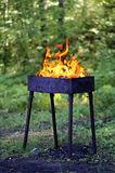 Brazier with fire. Shooting outdoors, on Royalty Free Stock Photography