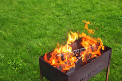 Brazier on lawn Stock Photo