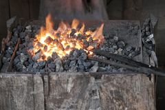 Brazier lit in the forge of a blacksmith stock photos