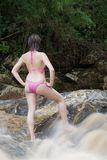 Sexy Brazilian girl playing and swimming in a local river Stock Photos