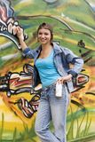 Brazil. Beautiful Brazilian girl spray painting a mural on the side of a building Royalty Free Stock Image