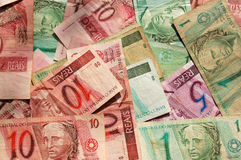 Brazil banknote background. A collection of Brazillian banknotes scattered about Stock Images
