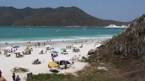 Brazil beach. CABO FRIO, BRAZIL - OCTOBER 17, 2014: People visit Cabo Frio Prainhas beach in state of Rio de Janeiro in Brazil. Brazil had 5.17 million visitors stock video