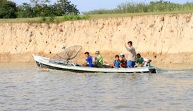 Brazil, Óbidos: Amazon River - Brazilian Family In Boat With GPS Dish Royalty Free Stock Images