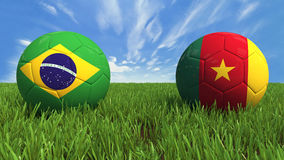 Brazil - Cameroon. 3D soccer balls with Brazil and Cameroon flag, world football cup 2014. Palaced on 3d grass. Background isolated with clipping path Royalty Free Stock Photography