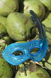 Brazil Carival Mask Green Coconuts. Shiny blue carnival mask sits on pile of fresh green Brazilian coconuts Stock Photography