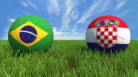 Brazil - Croatia. 3D soccer balls with Brazil and Cameroon flag, world football cup 2014. Palaced on 3d grass. Background isolated with clipping path Stock Image
