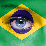 Brazil flag. On woman face royalty free stock photo