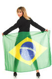 Brazil flag. Young woman holding Brazil flag on her back royalty free stock photos