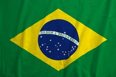 Brazil flag blowing in the wind. Fabric texture of the flag of Brazil stock images