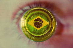 Brazil flag. On the bottom of a glass against a blurry background Royalty Free Stock Photos