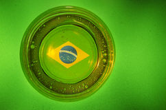 Brazil flag. On the bottom of a glass of beer Stock Images