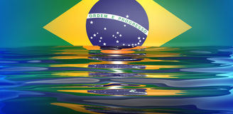 Brazil 2014 flag. Brazilian flag reflecting on the water Royalty Free Stock Photos