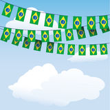 Brazil flag bunting. On cloud background with space for your text Royalty Free Stock Photo