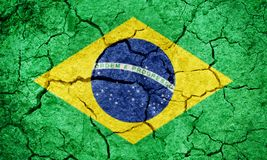 Federative Republic of Brazil flag. Brazil flag on dry earth ground texture background Stock Photo