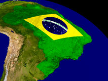 Brazil with flag on Earth Stock Image