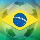 Brazil flag and football ball, flat design. Brazilian flag over soccer ball over green background, flat design Stock Image
